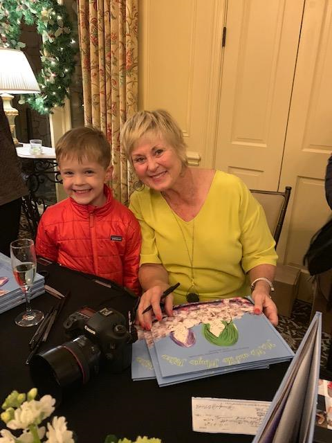 Helen and grandson at book signing